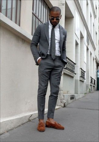 Grey Tie Outfits For Men: This polished pairing of a grey suit and a grey tie is a frequent choice among the dapper chaps. For something more on the daring side to complete this getup, complete this ensemble with tobacco suede tassel loafers.