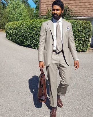 Grey Suit Outfits: This combination of a grey suit and a white dress shirt exudes elegance and refinement. Let your styling skills really shine by finishing off your look with brown leather tassel loafers.