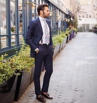 Suspenders Outfits: This casual combo of a navy vertical striped suit and suspenders comes to rescue when you need to look laid-back and cool in a flash. Dark brown leather tassel loafers are the simplest way to inject an element of sophistication into this ensemble.