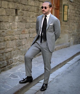 Black Socks Outfits For Men: A grey suit and black socks are the perfect foundation for a variety of dapper getups. Put a different spin on an otherwise standard look with a pair of black leather tassel loafers.