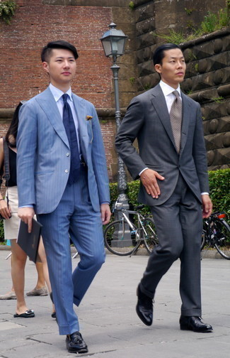 1200+ Outfits For Men In Their 20s: For a look that's nothing less than gasp-worthy, go for a blue vertical striped suit and a light blue dress shirt. Complement this ensemble with a pair of black leather tassel loafers for extra fashion points. As you're progressing through your late 20s, you probably want to start dressing in a more elegant manner. If that's the case, combos like this are perfect as inspiration.
