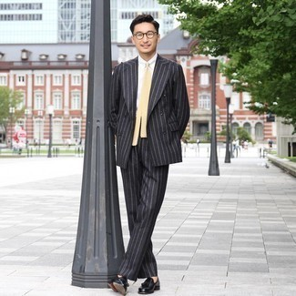 Sunglasses Outfits For Men: Nail off-duty look by wearing a black vertical striped suit and sunglasses. A pair of black leather tassel loafers can instantly dress up your getup.