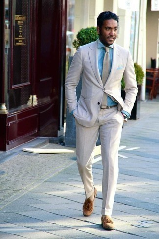 Beige Suit Outfits: Consider pairing a beige suit with a light blue chambray dress shirt and you'll be the picture of sophisticated men's style. Balance your outfit with a more relaxed kind of shoes, like this pair of brown suede tassel loafers.