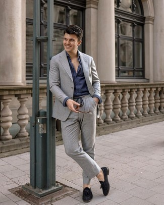 Navy Dress Shirt Outfits For Men: You'll be amazed at how very easy it is to get dressed like this. Just a navy dress shirt worn with a grey suit. To give this outfit a more casual vibe, add black suede tassel loafers to the mix.