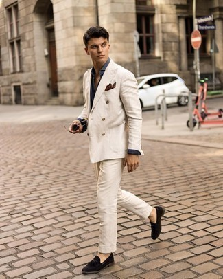 Navy Dress Shirt Outfits For Men: This combo of a navy dress shirt and a beige suit couldn't possibly come across other than ridiculously sharp and elegant. Our favorite of a variety of ways to round off this outfit is black suede tassel loafers.
