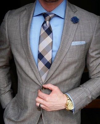 How to Wear a Brown Check Suit: Dress to impress in a brown check suit and a light blue dress shirt.
