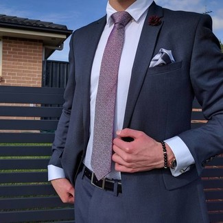 Burgundy Lapel Pin Outfits: Rock a navy suit with a burgundy lapel pin for neat menswear style.