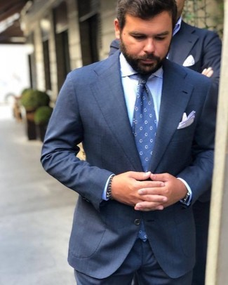 Marry a navy suit with a white pocket square for a classic and refined silhouette. This one will play especially nice when hot weather hits.