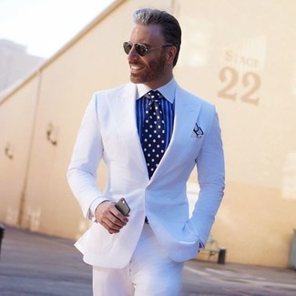 How to wear: white suit, white and blue vertical striped dress shirt, navy and white polka dot tie, white pocket square