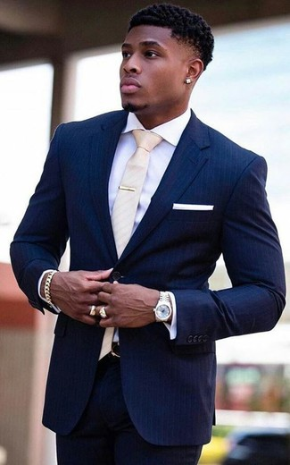 How to wear: navy vertical striped suit, white dress shirt, beige tie, white pocket square