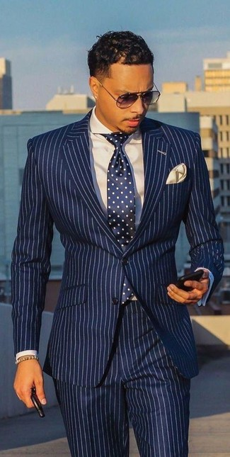 How to wear: white and navy vertical striped suit, white dress shirt, navy and white polka dot tie, beige pocket square
