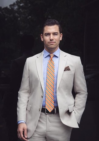 How to wear: beige suit, light blue chambray dress shirt, orange horizontal striped tie, burgundy print pocket square