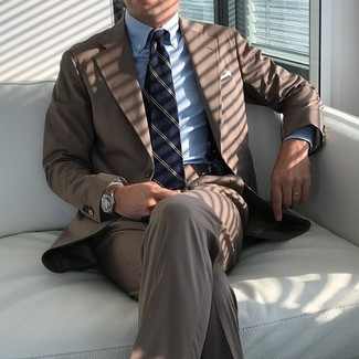 How to wear: brown suit, light blue vertical striped dress shirt, navy vertical striped tie, white pocket square