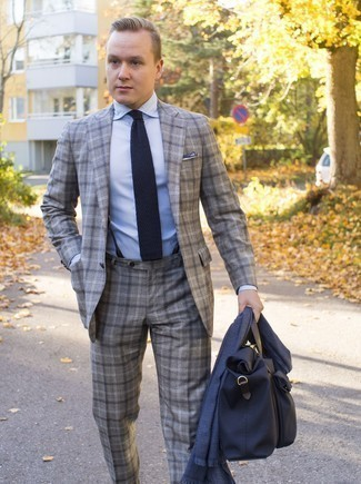How to Wear a Grey Plaid Suit: Try teaming a grey plaid suit with a light blue dress shirt for a sleek polished look.