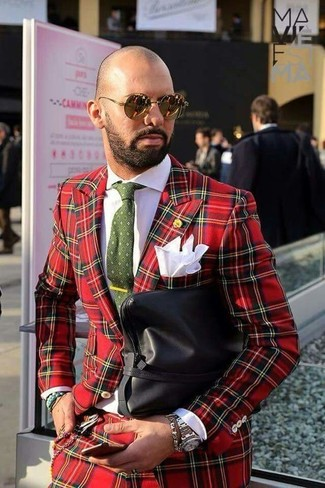 How to wear: red plaid suit, white dress shirt, black leather zip pouch, olive print tie