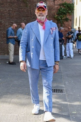 How to Wear Sunglasses For Men: You'll be amazed at how easy it is for any gent to pull together this off-duty outfit. Just a light blue suit and sunglasses. And if you need to effortlessly dress down this outfit with one single piece, why not complete your look with a pair of white leather high top sneakers?
