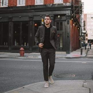 Black Hoodie Outfits For Men: For something on the classic and casual side, try pairing a black hoodie with a dark brown suit. If you want to break out of the mold a little, complete your look with beige suede low top sneakers.