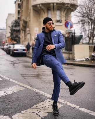 Black Hoodie Outfits For Men: For a semi-casual look, dress in a black hoodie and a blue suit — these two pieces play beautifully together. Finishing with black leather low top sneakers is a fail-safe way to inject a more laid-back feel into this look.