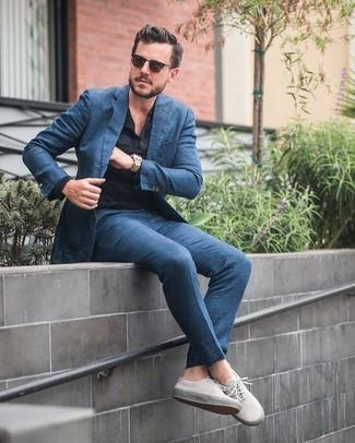 How to wear: blue suit, black long sleeve henley shirt, beige canvas low top sneakers, dark brown sunglasses