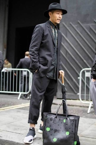 How to Wear a Black Wool Hat For Men: For a cool and casual outfit, dress in a black suit and a black wool hat — these items play nicely together. Let your sartorial credentials truly shine by finishing this ensemble with black and white athletic shoes. Rock this getup to showcase your maturity even as a 20-something gentleman.