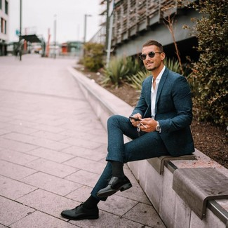 How to wear: teal wool suit, white long sleeve shirt, black leather derby shoes, black sunglasses