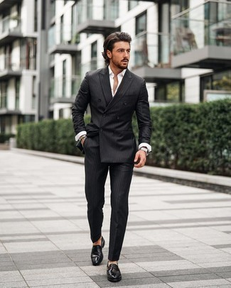 Black Vertical Striped Suit Outfits: Opt for a black vertical striped suit and a white long sleeve shirt and you'll don a neat and elegant look. To bring out a polished side of you, complete your getup with a pair of black leather loafers.