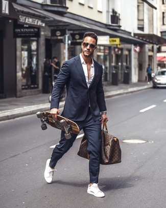 How to wear: navy suit, white long sleeve shirt, white leather low top sneakers, dark brown print leather holdall