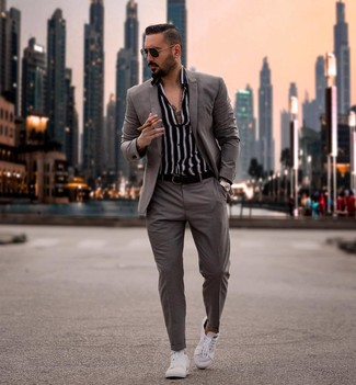 Grey Suit with Long Sleeve Shirt Outfits: Make a grey suit and a long sleeve shirt your outfit choice for a truly smart ensemble. Hesitant about how to finish? Complement your outfit with white low top sneakers to jazz things up.