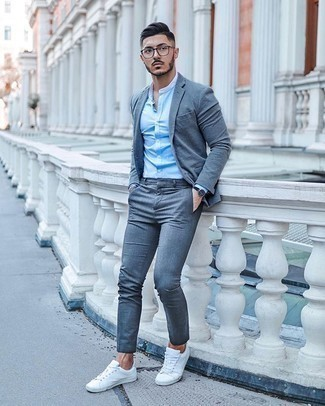 Grey Suit Outfits: Marrying a grey suit with a light blue long sleeve shirt is an on-point option for a smart and sophisticated ensemble. Complement this look with a pair of white canvas low top sneakers to inject an element of stylish effortlessness into your outfit.