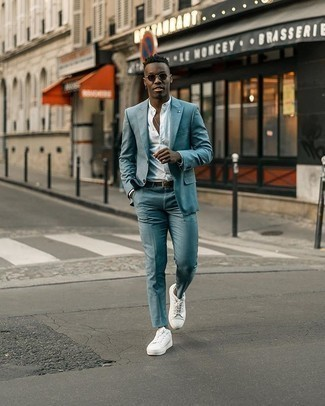 Men's Outfits 2020: Want to infuse your closet with some effortless cool? Consider wearing a white long sleeve shirt. Play down your getup by rounding off with white canvas low top sneakers.
