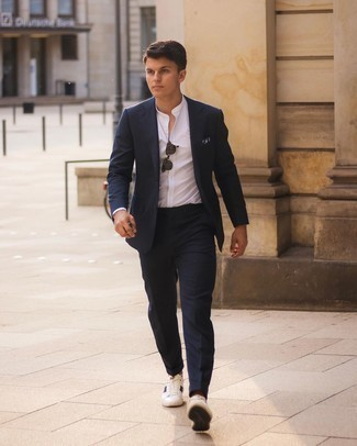 White Long Sleeve Shirt Outfits For Men: Opt for a white long sleeve shirt and a navy suit to be the epitome of class. For a more laid-back feel, why not add a pair of white and navy leather low top sneakers to the mix?