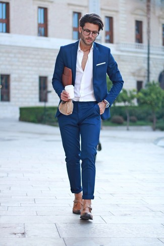How to wear: navy suit, white long sleeve shirt, tan leather monks, brown leather zip pouch