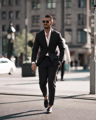 How to wear: black suit, white long sleeve shirt, black leather tassel loafers, black sunglasses