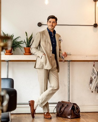 How to wear: beige suit, navy chambray long sleeve shirt, tobacco suede tassel loafers, dark brown leather holdall