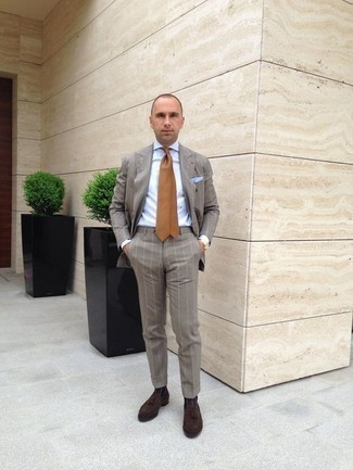 How to Wear a Tan Tie For Men: This combo of a grey vertical striped suit and a tan tie is a goofproof option when you need to look extra classy. Get a bit experimental on the shoe front and complement this ensemble with dark brown suede tassel loafers.