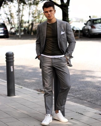 Grey Suit Outfits: As you can see, it doesn't take that much effort for a man to look casually classic. Marry a grey suit with a white crew-neck t-shirt and you'll look amazing. Introduce white leather low top sneakers to the mix to instantly rev up the cool of your look.