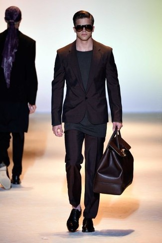 How to wear: black suit, charcoal long sleeve t-shirt, black leather oxford shoes, dark brown leather duffle bag