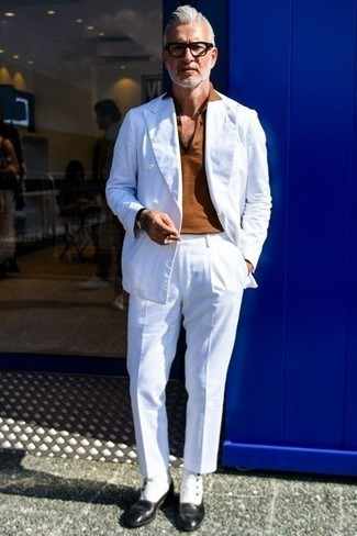 White Suit Smart Casual Outfits: This smart combo of a white suit and a tobacco polo is capable of taking on different nuances depending on how you style it out. White and black leather chelsea boots are a fitting option here.