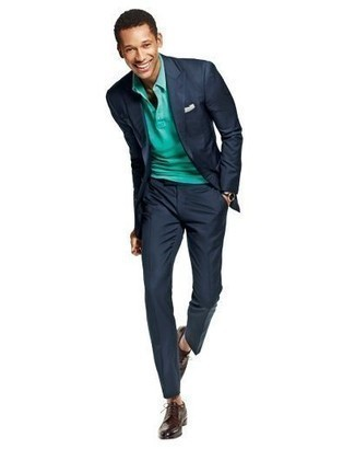 Navy Suit Outfits: For an ensemble that's worthy of a modern sartorially savvy man and casually smart, opt for a navy suit and a green polo. Punch up your outfit with a pair of dark brown leather derby shoes.