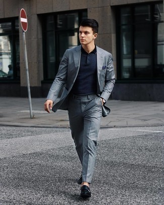 Men's Outfits 2021: Consider wearing a grey suit and a navy print polo to put together an interesting and modern-looking outfit. Rounding off with a pair of navy leather double monks is a surefire way to infuse an element of class into your outfit.