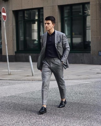 Men's Outfits 2021: For something on the smart side, pair a grey suit with a navy print polo. And if you need to instantly step up your look with one single item, complete this outfit with black leather double monks.