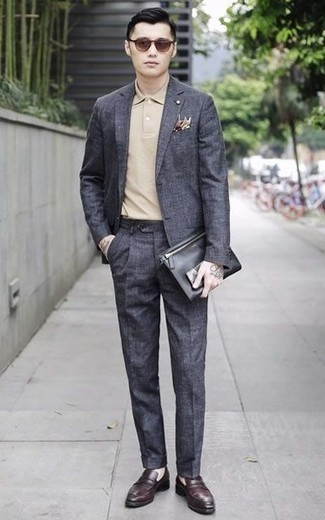 How to Wear Burgundy Leather Loafers For Men: This pairing of a charcoal suit and a beige polo couldn't possibly come across as anything other than outrageously sharp and casually smart. And if you want to effortlessly ramp up this look with shoes, add burgundy leather loafers to the equation.