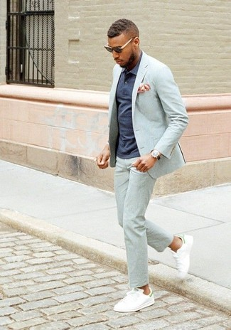 How to wear: grey suit, navy polo, white leather low top sneakers, orange print pocket square