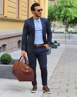 Brown Woven Leather Belt Outfits For Men: A navy suit and a brown woven leather belt are a savvy pairing worth having in your daily fashion mix. For extra style points, complete this ensemble with brown leather low top sneakers.