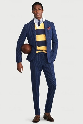 How to wear: navy vertical striped suit, yellow horizontal striped polo neck sweater, light blue dress shirt, dark brown leather tassel loafers