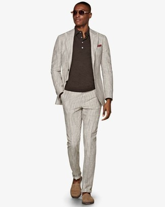 How To Wear a Suit With a Polo Neck Sweater: A suit and a polo neck sweater are among the basic elements of a classy menswear collection. Tone down the dressiness of this ensemble by wearing a pair of beige suede espadrilles.