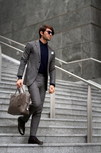 How to wear: charcoal suit, navy polo, dark brown leather tassel loafers, grey leather briefcase