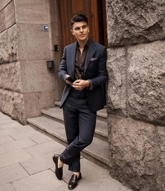 Dark Brown Leather Loafers Outfits For Men: A navy check suit and a dark brown short sleeve shirt worn together are a sartorial dream for gentlemen who appreciate refined combos. For something more on the smart side to round off your look, add dark brown leather loafers to the equation.