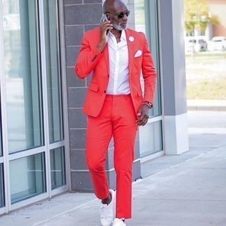 1200+ Outfits For Men After 50: Combining a red suit with a white short sleeve shirt is a nice option for a sharp and sophisticated look. If you need to immediately dial down your outfit with one single item, finish off with white canvas low top sneakers. This pairing demonstrates how to look good as you get into your 50s.