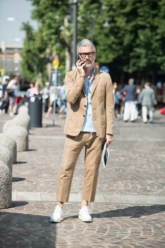How to Wear a Light Blue Short Sleeve Shirt For Men: Opt for a light blue short sleeve shirt and a tan suit and you'll be the definition of sophistication. For a more sophisticated touch, why not introduce a pair of white leather oxford shoes to your look?